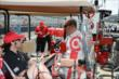Tony Kanaan speaks with Dario Franchitti in pit lane -- Photo by: Jim Haines