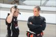 Juan Pablo Montoya chatting with a crew member -- Photo by: Jim Haines