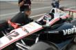 Juan Pablo Montoya speaks with teammate Will Power -- Photo by: Jim Haines