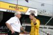 Helio Castroneves speaks with team owner Roger Penske -- Photo by: Jim Haines