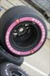 Pink Firestone tires for Pippa Mann's car -- Photo by: Joe Skibinski