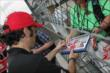 Dario Franchitti signing autographs -- Photo by: Joe Skibinski