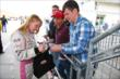 Pippa Mann signs autographs for fans -- Photo by: Chris Jones