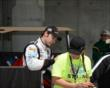 Simon Pagenaud signs an autograph -- Photo by: Jim Haines
