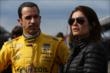 Helio Castroneves and his wife in pit lane -- Photo by: Shawn Gritzmacher