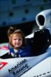 Young fan in an IndyCar -- Photo by: Eric Anderson