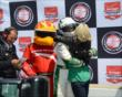Wife Heather hugs Ed Carpenter after his pole position win -- Photo by: Jim Haines
