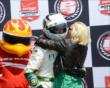 Ed Carpenter receives a hug from his wife after winning pole -- Photo by: Jim Haines