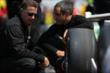 Juan Montoya speaks with an engineer -- Photo by: Shawn Gritzmacher