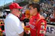 Sebastian Saavedra speaks with Al Unser Jr. -- Photo by: Chris Jones