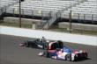 Oriol Servia and Takuma Sato -- Photo by: Jim Haines