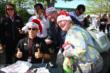 Helio Castroneves poses with fans at IMS -- Photo by: Bret Kelley