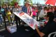 Dario Franchitti signs an autograph -- Photo by: Bret Kelley