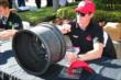 Scott Dixon signs an autograph -- Photo by: Bret Kelley