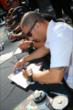 Tony Kanaan signs an autograph -- Photo by: Bret Kelley