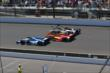 Cars head down track at IMS -- Photo by: Bret Kelley