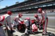 Tony Kanaan's team works on the car -- Photo by: Chris Jones