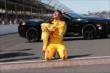 Ryan Hunter-Reay celebrates with his son at the yard of bricks -- Photo by: Chris Jones