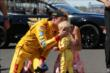 Ryan Hunter-Reay kisses his son -- Photo by: Chris Jones