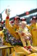 Ryan Hunter-Reay with his son in Victory Circle -- Photo by: Chris Owens