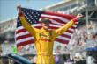 Ryan Hunter-Reay hold the American flag -- Photo by: Chris Owens