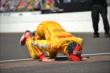 Ryan Hunter-Reay kisses the bricks -- Photo by: Chris Owens