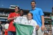 Andrew Luck and Mark Cuban receive the green the flag at IMS -- Photo by: Dana Garrett