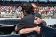 Johnny Rutherford hugs Dario Franchitti -- Photo by: Dana Garrett