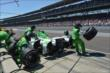 Pit stop for Carlos Munoz -- Photo by: Dana Garrett
