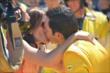 Helio Castroneves kisses his wife after the Indianapolis 500 -- Photo by: Dana Garrett