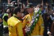 Ryan Hunter-Reay speaks with Helio Castroneves after his victory -- Photo by: Dana Garrett
