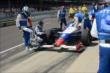 Ryan Briscoe inspects his car -- Photo by: Jim Haines