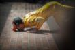 Ryan Hunter-Reay kisses the bricks -- Photo by: Shawn Gritzmacher