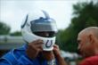 Wide Receiver Reggie Wayne slips on his Indianapolis Colts drivers helmet -- Photo by: Brian Simpson