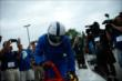 Indianapolis Colts wide receiver Reggie Wayne climbs out of the IndyCar Two-Seater upon arriving at the Indianapolis Colts Training Camp -- Photo by: Brian Simpson