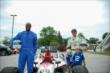 Indianapolis Colts wide receiver Reggie Wayne and Ed Carpenter pose with the IndyCar Two-Seater at the Indianapolis Colts Training Camp -- Photo by: Brian Simpson