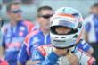 Takuma Sato adjusts his helmet prior to his qualification run for the ABC Supply Wisconsin 250 from the Milwaukee Mile -- Photo by: Chris Owens