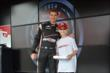 Will Power gives out a free iPad air to a lucky fan in the INDYCAR Fan Village at Milwaukee -- Photo by: Chris Owens