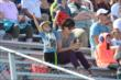 A young fan cheers on the action at the Milwaukee Mile -- Photo by: Chris Owens