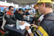 Helio Castroneves signs an autograph during the autograph session in the INDYCAR Fan Village at Milwaukee -- Photo by: Chris Owens
