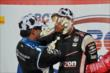 Will Power takes a cream puff to the face from Juan Pablo Montoya in Victory Lane after winning the ABC Supply Wisconsin 250 at the Milwaukee Mile -- Photo by: Chris Owens