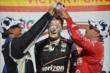 Will Power gets a cream puff to the head from Juan Pablo Montoya and Tony Kanaan in Victory Lane at the Milwaukee Mile -- Photo by: Chris Owens
