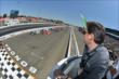 GoPro President Tony Bates shows the green flag to start the GoPro Grand Prix of Sonoma at Sonoma Raceway -- Photo by: Chris Owens