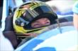 Sarah Fisher gets prepped for giving a few two-seater rides at Auto Club Speedway -- Photo by: Chris Owens