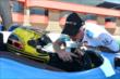 Sarah Fisher receives instructions on operating the INDYCAR two-seater at Auto Club Speedway -- Photo by: Chris Owens