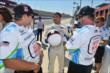 Boxer Victor Ortiz chats with the INDYCAR Experience crew after his two-seater ride at Auto Club Speedway -- Photo by: Chris Owens