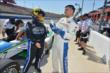 Sarah Fisher and boxer Victor Ortiz chat after their INDYCAR two-seater ride at Auto Club Speedway -- Photo by: Chris Owens