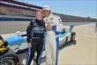 Sarah Fisher and boxer Victor Ortiz pose after their INDYCAR two-seater ride at Auto Club Speedway -- Photo by: Chris Owens