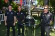 Simon Pagenaud, Helio Castroneves, and Will Power stand alongside the Astor Cup during the media availability at The Grove LA -- Photo by: Chris Owens