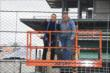 Helio Castroneves helps finish construction of IMS track fence - Wednesday, February 3, 2016